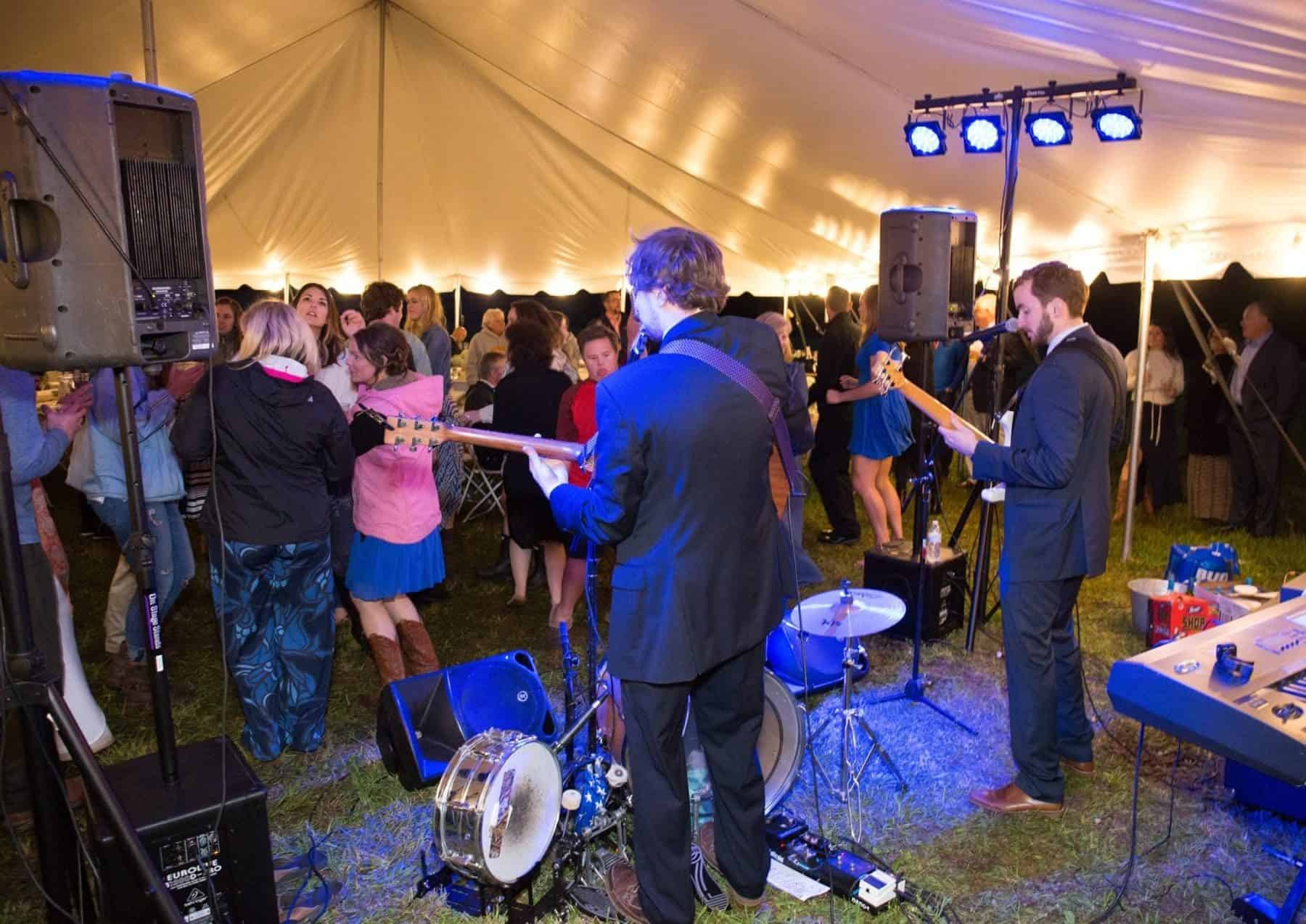 Band Playing During An Outdoor Tent Wedding