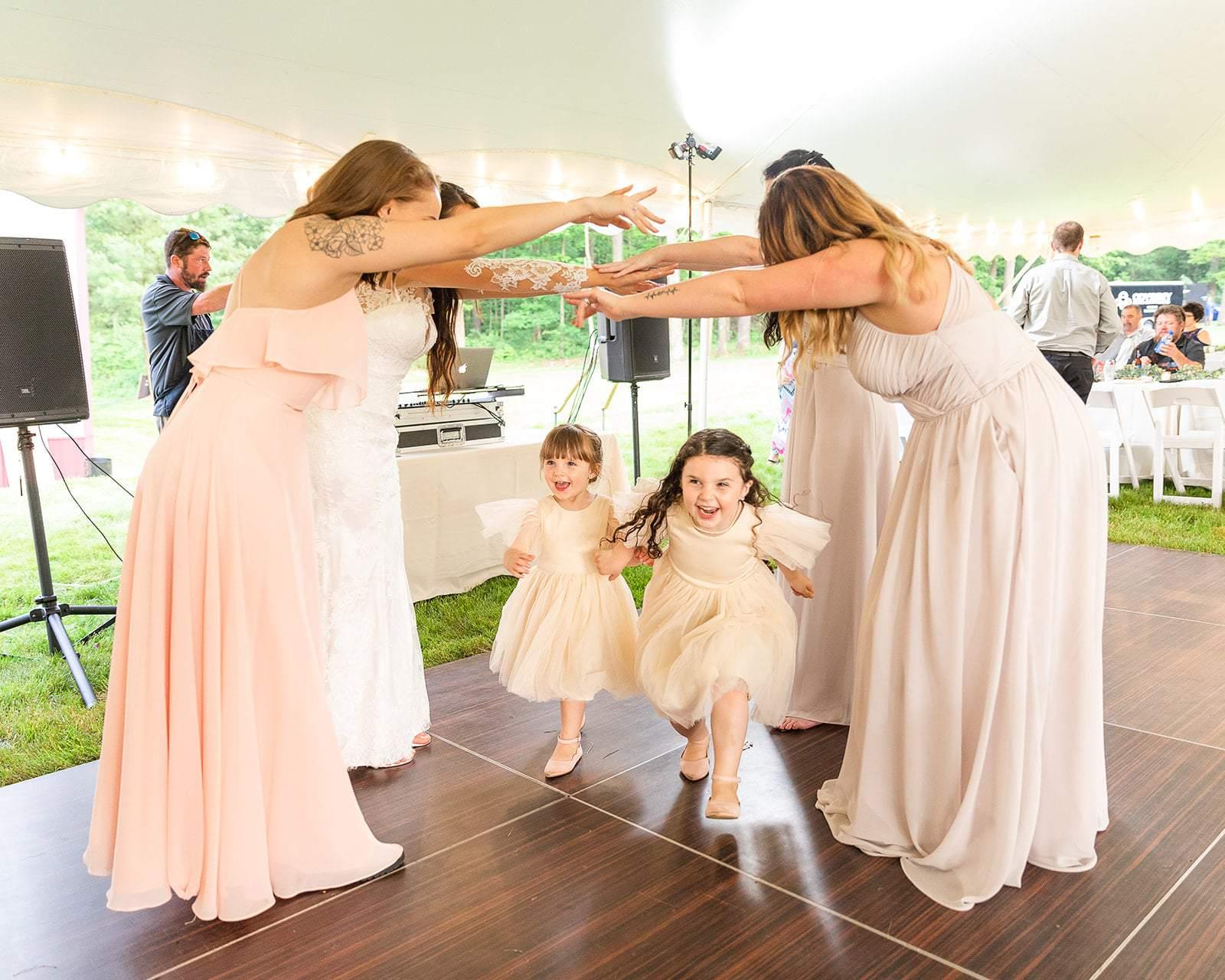 Cute Flower Girls Dancing At An Outdoor Tent Reception