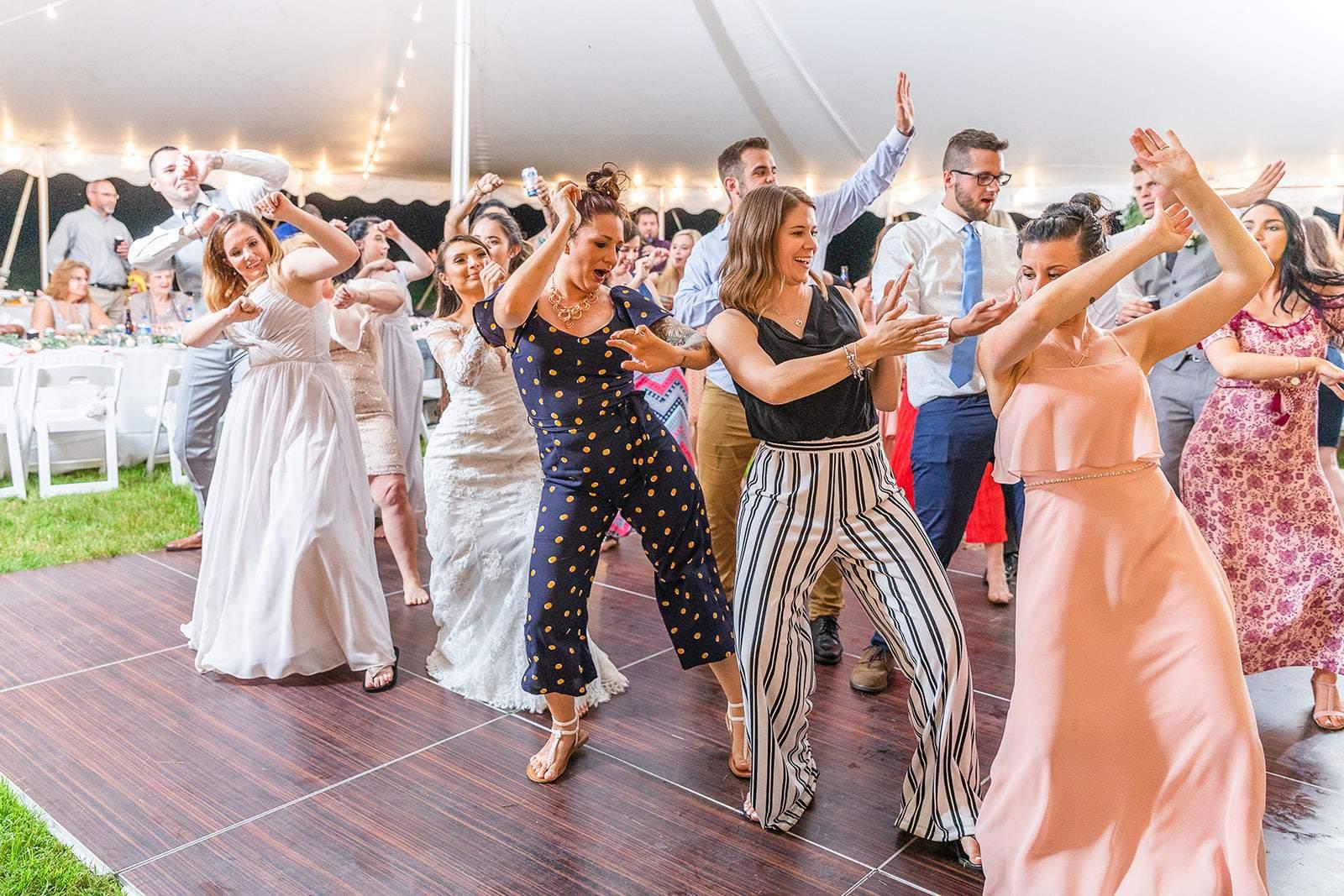 Full Dance Floor At Outdoor Tent Wedding Reception